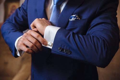 Businessman hands with cufflinks. Elegant gentleman clother