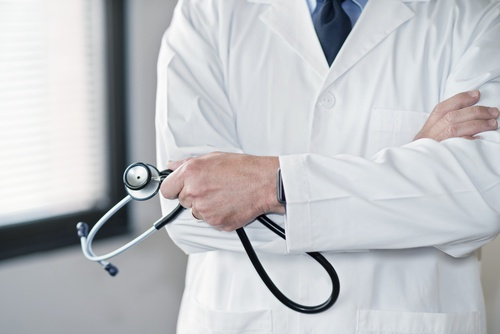 Male doctor in white coat with stethoscope