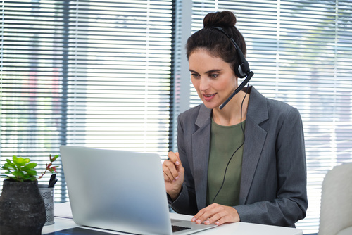 Female executive doing video call on laptop